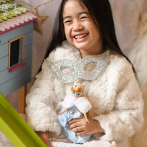 Girl laughing and holding Snow Queen Lottie