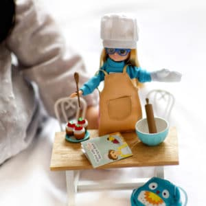 Cake Bake Outfit - Lottie: Lifestyle shot of Cool 4 School Lottie with Cake Bake Outfit and accessories