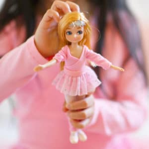 Girl holding Ballet Class Lottie