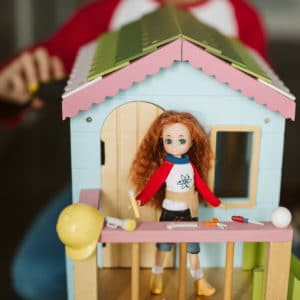 Young Inventor – Lottie on dollhouse with tools
