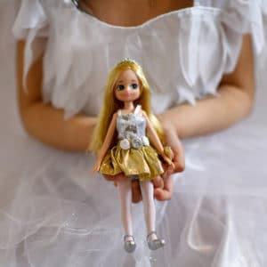 Girl in ballerina costume holding Swan Lake Lottie