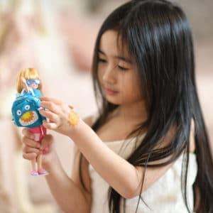 Girl playing with Cool 4 School Lottie