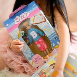Girl holding Cool 4 School Lottie in Packaging
