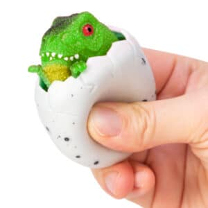 Squeezy Egg Popper toy in hand, squeezed and green dino popping out